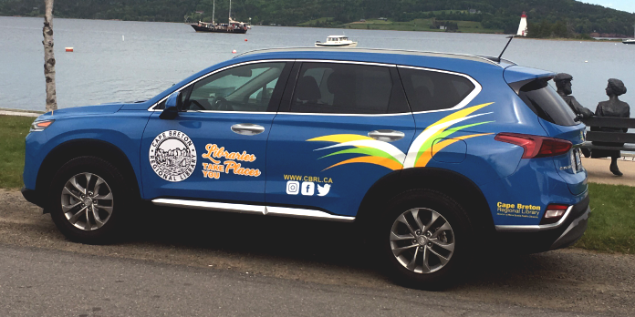 Image of Victoria County Outreach vehicle: a blue Hyundai Santa Fe with Cape Breton Regional Library brand images.