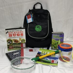 Insects Nature backpack with contents on display: Secret Lives of Backyard bugs book; community nature journal; insects nature backpack instructions; Smithsonian Bug Hunter children's book; butterfly net; insect observation tank; Nature Wildlife Federation Field Guide to Insects book.