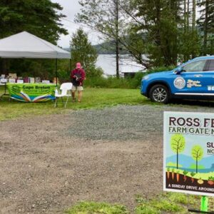 Library outreach table and vehicle at the Ross Ferry Farm Gate Market